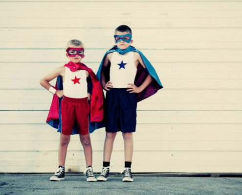 Two Boys Dressed as Caped Superhero's - What's Your Role in The Drama Triangle - Sandra Harewood Counselling