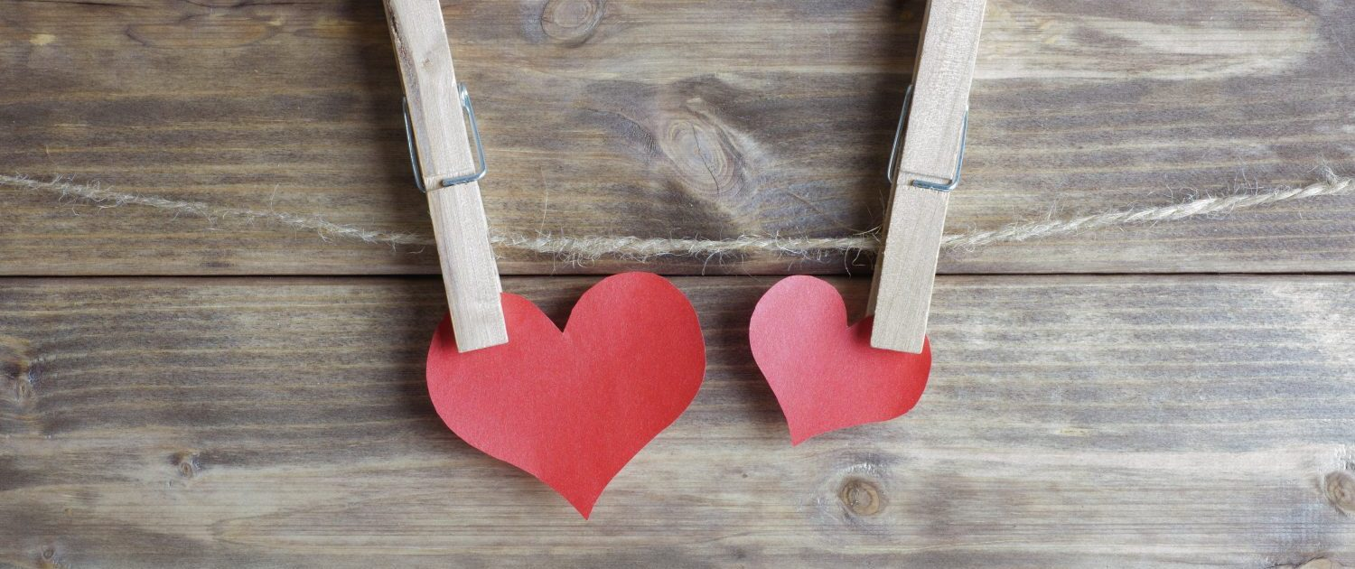 Two-Red-Paper-Hearts-Attached-to-a-Rope-with-Clothes-Pegs-Sandra-Harewood-Counselling - Couples Counselling Norwood London