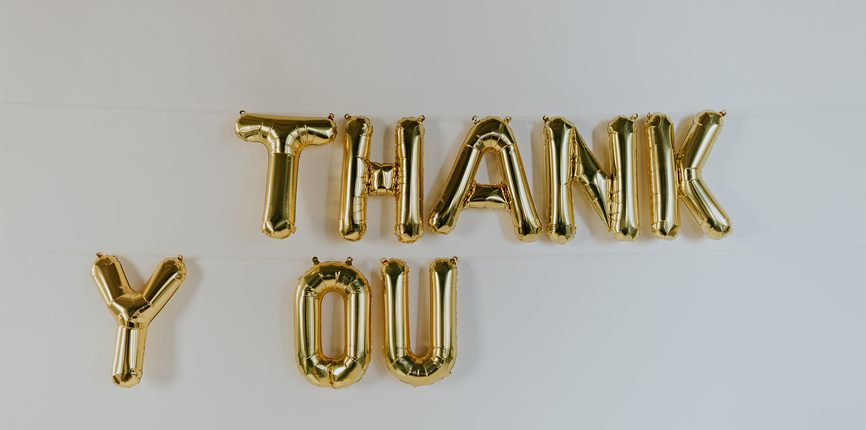 "Gold ""THANK YOU"" balloon letters hanging on the wall = How Showing Your Partner Appreciation Can Help Improve Your Relationship - Sandra Harewood Counselling"