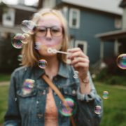 A Woman Blowing Bubbles - How Playfulness Can Help Improve Your Relationship - Sandra Harewood Counselling