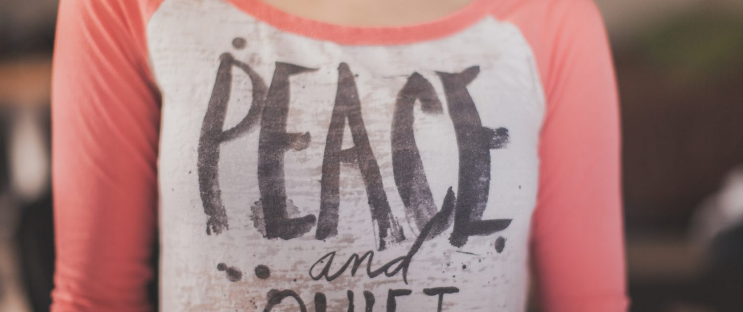 Woman wearing peace and quiet t-shirt - National Quiet Day - Why silence Speaks Volumes - Sandra Harewood Counselling