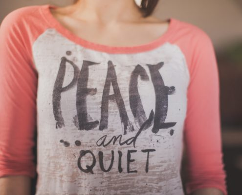 Woman wearing peace and quiet t-shirt - National Quiet Day - What Silence Can Teach You About Intimacy - Sandra Harewood Counselling