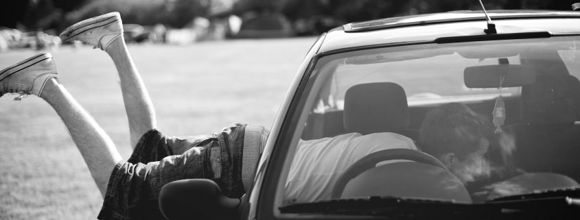 Teen boy with his feet hanging out of a car window - Teen boy with his feet hanging out of a car window - Childhood Wounding Relationship - Sandra Harewood Counselling Childhood Wounding Relationship - Sandra Harewood Counselling