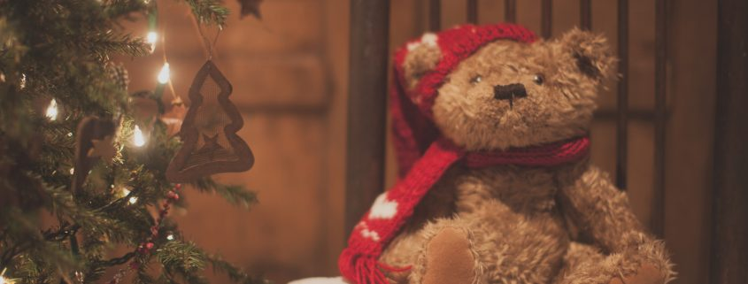A Holiday Teddy Bear on A Stool - How To Survive Christmas And Reduce Your Christmas Anxiety - Christmas isn't a happy time for everyone. You might feel stamped if you feel a little low without quite understanding why. This post will give you some tips on how to feel less anxious and take care of yourself.