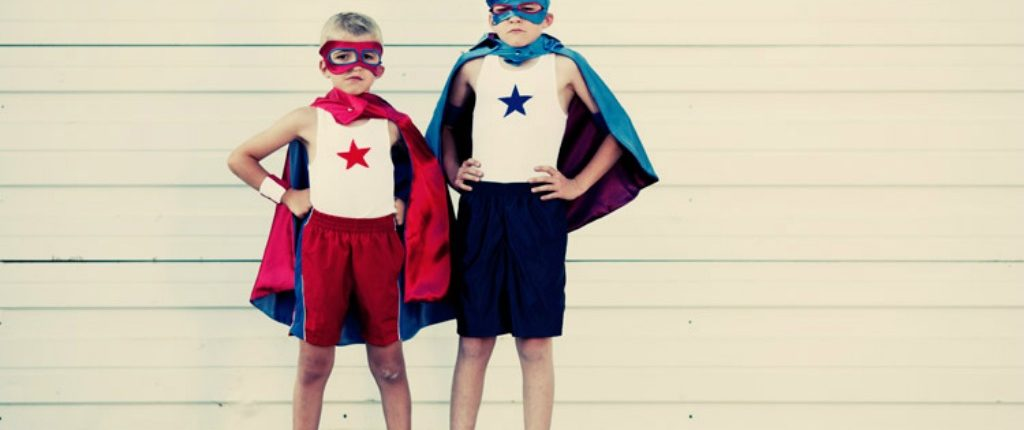 Two Boys Dressed as Caped Superhero's - What's You're Role in The Drama Triangle - Sandra Harewood Counselling