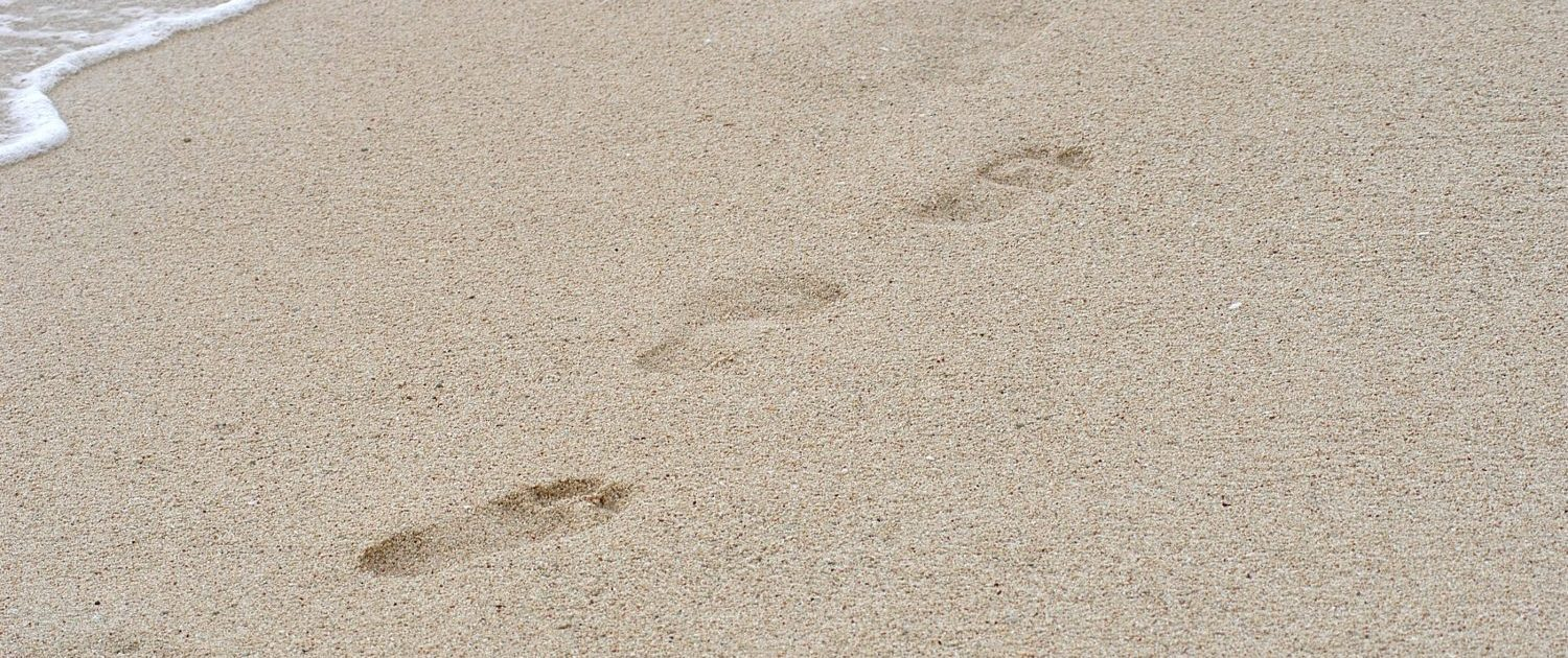Footsteps in the Sand on Beach - Sandra Harewood Counselling - Counselling First Steps