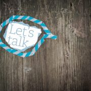 Let's Talk Note in Blue Speech Bubble on Wooden Surface -Worried About Your First Counselling Session? Here's How to Prepare - Sandra Harewood Counselling