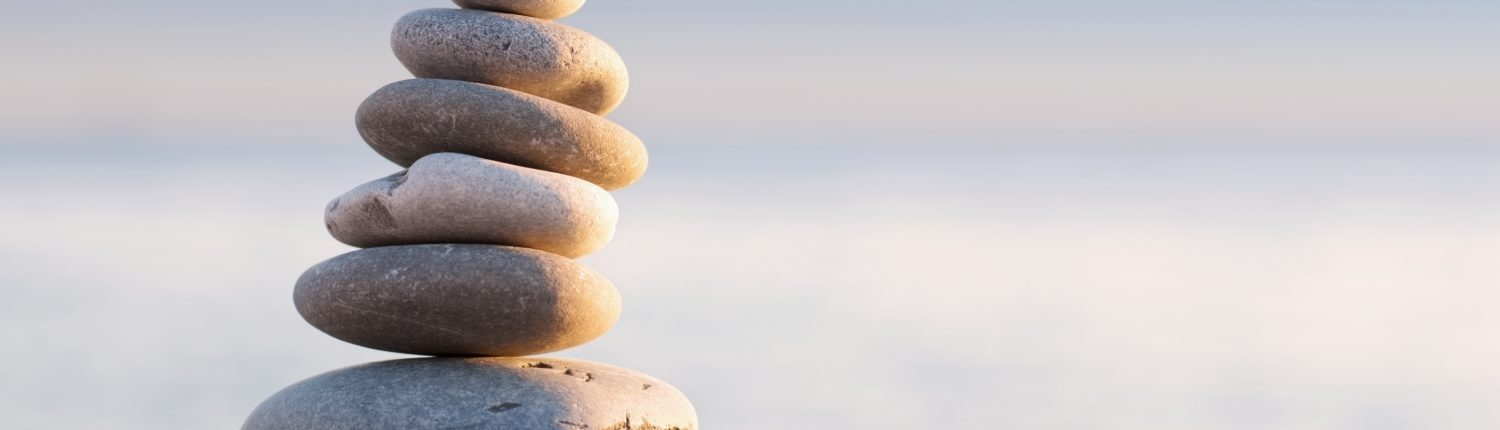 Close up of Stack of Pebbles Against Blue Skyline - Individual Counselling - Sandra Harewood Counselling