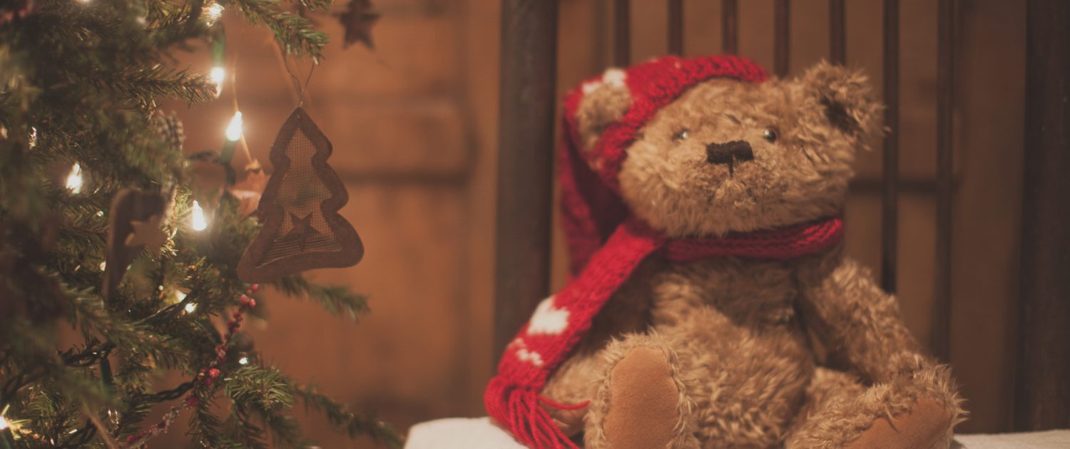 A Holiday Teddy Bear On A Stool And A Christmas Tree - How To Survive Christmas - Sandra Harewood Counselling
