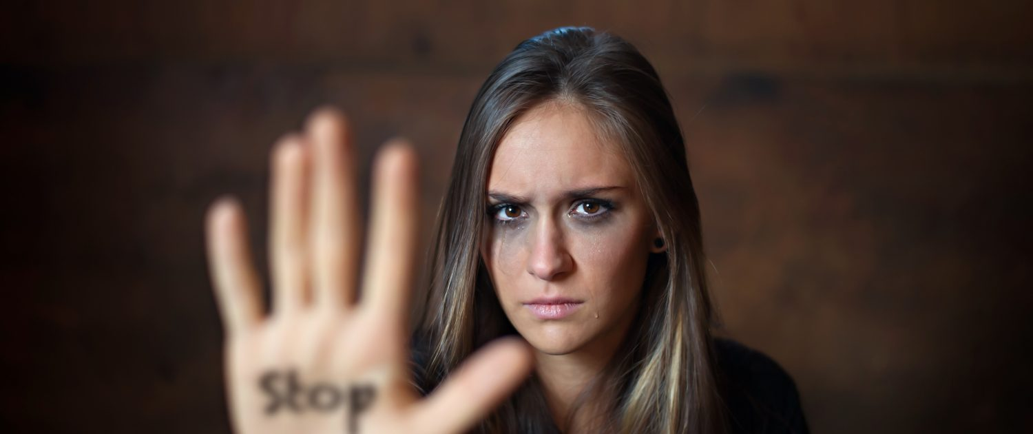 Woman with her arm outstretched with the word written on her hand. The Honest Truth About Your Partner's Anger Issues. Sandra Harewood Counselling