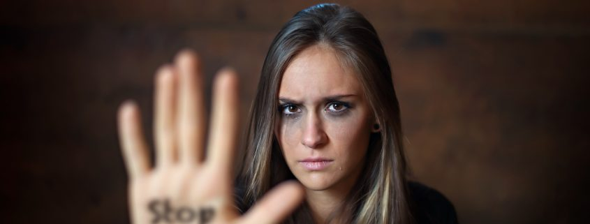 Woman with her arm outstretched with the word written on her hand. The Surprising Ways You Hide Your Anger. Anger is a natural human emotion, which many people push down and hide, but it seeps out anyway. This post will let you know how and why anger feels so difficult.