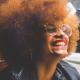 Black Woman With Afro Smiling - The Power of Owning Your Suppressed Anger: Reclaiming The Goddess