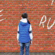 Girl Standing In Front of Brick Wall With Graffiti - The B* Word - Boundaries. Why It's Hard To Stop Saying Yes When You Feel No 1 - Sandra Harewood Counselling