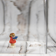Female Lego Toy In Glass Container With Male Lego Toy The Other Side of The Glasswork Looking In - How To Stay Connected When Social Isolating COVID19 - Sandra Harewood Counselling
