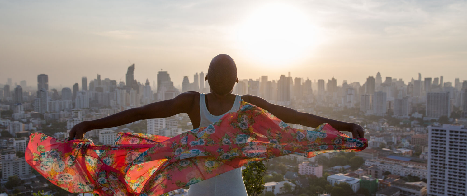 Woman Standing At The Rooftop With Her Scarf On The Wind - Counselling For Women - Sandra Harewood Counselling