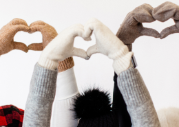 Three female friends together forming love hearts with hands. Friendship and happiness help to improve self care. Here's How To Improve Your Self-Care Practice Today-Sandra Harewood Counselling
